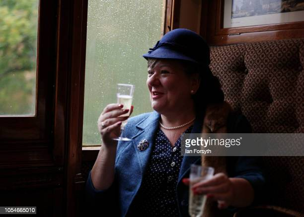 Theresa Hennigan from Loftus enjoys a drink on the train as she heads to Pickering during the North Yorkshire Moors Railway 1940's Wartime Weekend...
