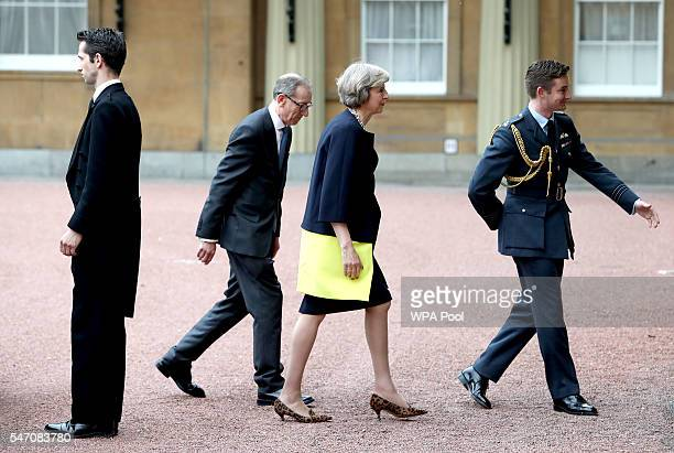 Theresa May and her husband Philip arrive at Buckingham Palace for an audience with Queen Elizabeth II where the former Home Secretary was invited to...