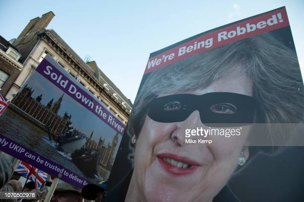 Theresa May as a robber in a mask at the Brexit Betrayal March Brexit Means Exit organised by the UK Independence Party described as a crossparty...