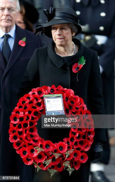 Theresa May attends the annual Remembrance Sunday Service at The Cenotaph on November 12 2017 in London England This year marks the first time that...