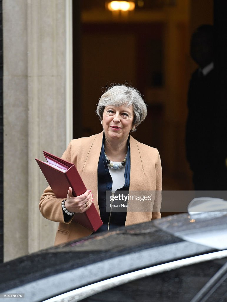Theresa May Leaves Downing Street For Prime Minister's Questions Ahead Of The 2017 Budget : News Photo
