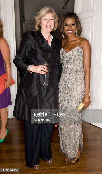 Theresa May MP and June Sarpong attend the launch of 'PoliticsAndTheCitycom' at ICA on July 8 2008 in London England