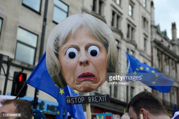 Theresa May Prime minister face mask seen during the protest Over a million people marched peacefully in central London in favor of a second...