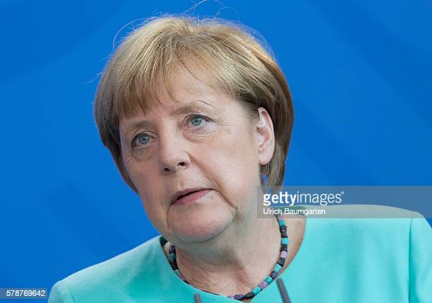 Theresa May Prime Minister of the United Kingdom attends a military welcome ceremony with German Chancellor Angela Merkel on July 20 2016 in Berlin...
