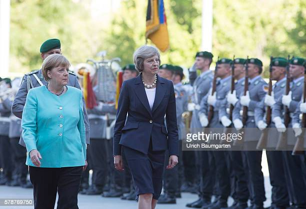 Theresa May Prime Minister of the United Kingdom attends a military welcome ceremony with German Chancellor Angela Merkel on July 20 2016 in Berlin