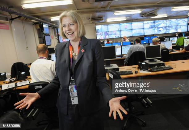 Theresa May reacts during an interview as she views the Olympics security control room in the Olympic park Stratford London