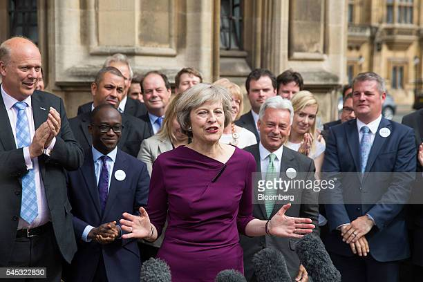 Theresa May UK home secretary center gestures as she speaks to members of the media after it was announced she won the secondround ballot of...
