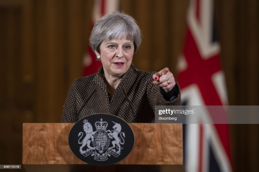 Theresa May, U.K. prime minister, addresses members of the media during a news conference at number 10 Downing Street following air strikes in Syria, in London, U.K., on Saturday, April 14, 2018. The U.S., U.K. and France hit targets in Syria in retaliation for an apparent chemical weapons attack outside Damascus by Bashar al-Assads regime. Photographer: Will Oliver/Pool via Bloomberg