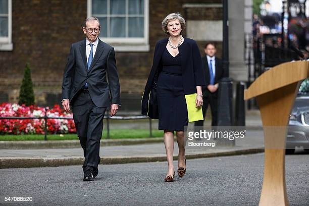 Theresa May UK prime minister and her husband Philip May arrive in Downing Street in London UK on Wednesday July 13 2016 May became the UK's second...