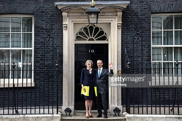 Theresa May UK prime minister and her husband Philip May pose for photographers outside 10 Downing Street in London UK on Wednesday July 13 2016 May...