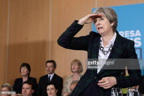 Theresa May UK prime minister and leader of the Conservative Party gestures while speaking during a generalelection campaign event in Nottingham UK...