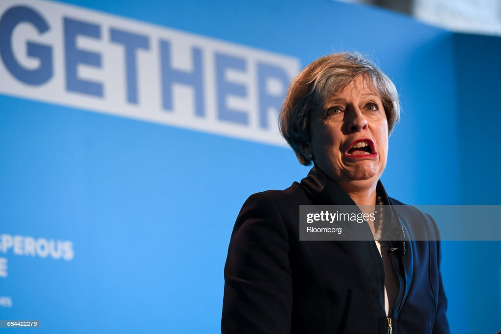 Theresa May, U.K. prime minister and leader of the Conservative Party, reacts during the launch of the party's general election manifesto at Dean Clough Mills in Halifax, U.K., on Thursday, May 18, 2017. May positioned herself as the champion of 'ordinary, working people' against 'elites' as she set out an election platform that represents a clean break with the way Britain has been governed for at least 30 years. Photographer: Chris J. Ratcliffe/Bloomberg via Getty Images