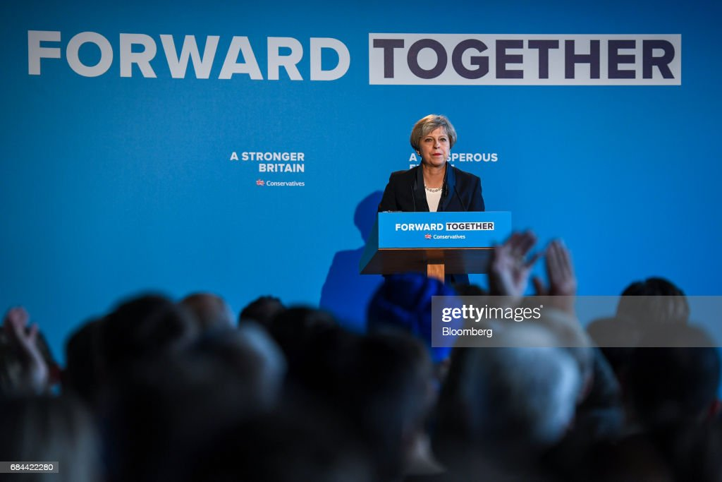 Theresa May, U.K. prime minister and leader of the Conservative Party, pauses during the launch of the party's general election manifesto at Dean Clough Mills in Halifax, U.K., on Thursday, May 18, 2017. Maypositioned herself as the champion of 'ordinary, working people' against 'elites' as she set out an election platform that represents a clean break with the way Britain has been governed for at least 30 years. Photographer: Chris J. Ratcliffe/Bloomberg via Getty Images