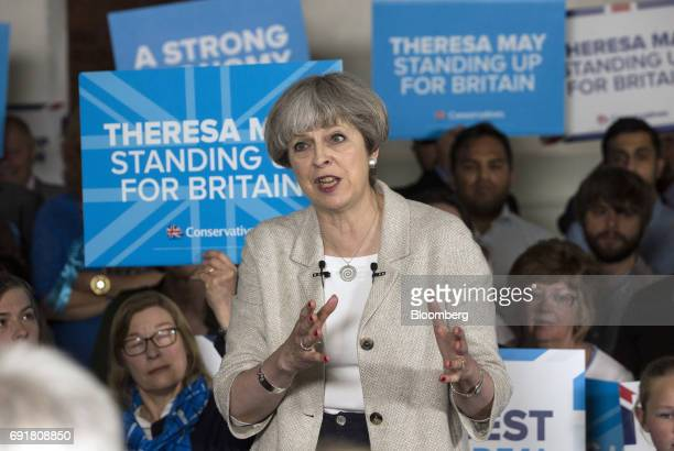 Theresa May UK prime minister and leader of the Conservative Party gestures as she speaks during a general election campaign tour stop at Thornhill...