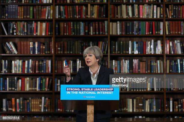 Theresa May UK prime minister and leader of the Conservative Party gestures while delivering a speech at the Royal United Services Institute in...