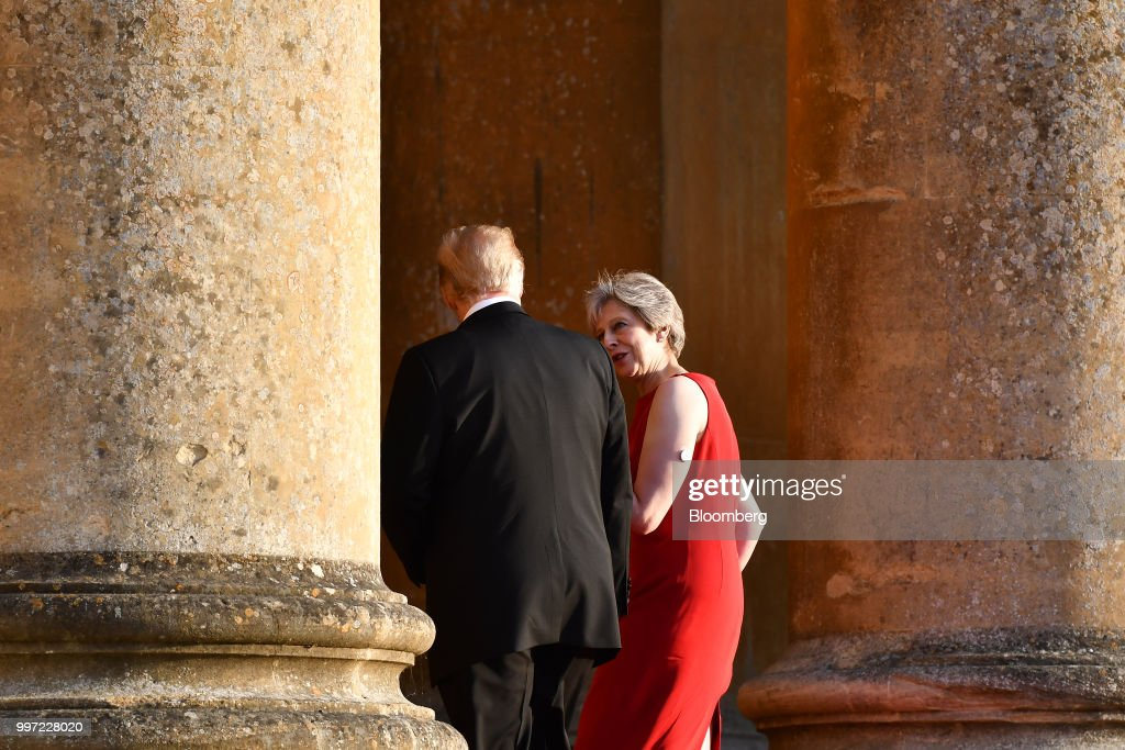 Theresa May, U.K. prime minister, and U.S. President Donald Trump, left, arrive at Blenheim Palace ahead of a dinner in Oxfordshire, U.K., on Thursday, July 12, 2018. Trump and the first lady will meet British business leaders at the black-tie dinner attended by more than 100 guests. Photographer: Ben Stansall/Pool via Bloomberg