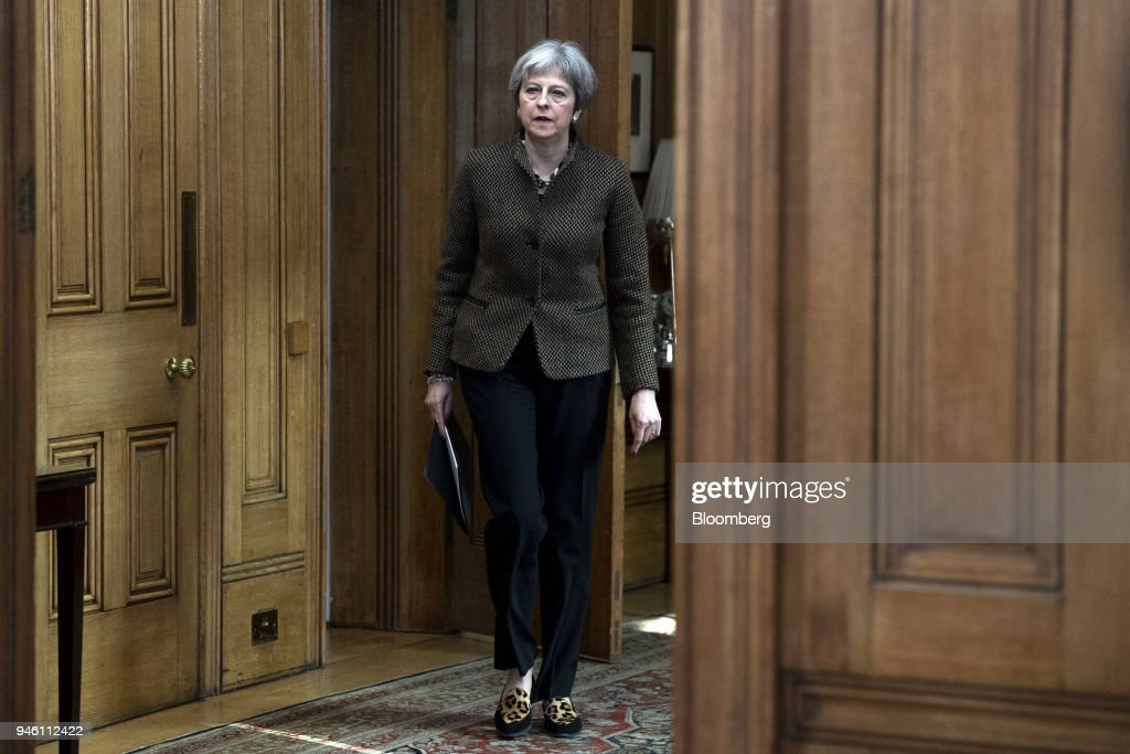 Theresa May, U.K. prime minister, arrives to speak at a news conference at number 10 Downing Street following air strikes in Syria, in London, U.K., on Saturday, April 14, 2018. The U.S., U.K. and France hit targets in Syria in retaliation for an apparent chemical weapons attack outside Damascus by Bashar al-Assads regime. Photographer: Will Oliver/Pool via Bloomberg