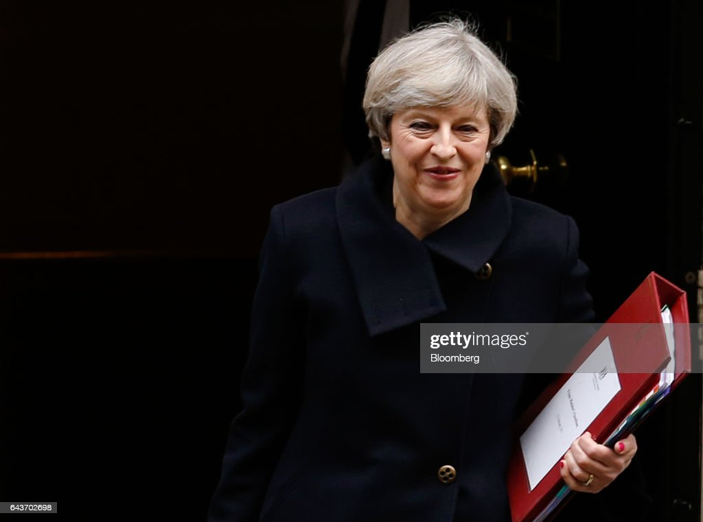 Theresa May, U.K. prime minister, carries a document folder as she leaves 10 Downing Street to attend the weekly question-and-answer session in the Houses of Parliament, in London, U.K., on Wednesday, Feb. 22, 2017. May came under pressure to tighten takeover rules, and do so quickly, in the wake of the failed Kraft Heinz Co. bid for Unilever Plc. Photographer: Luke MacGregor/Bloomberg via Getty Images