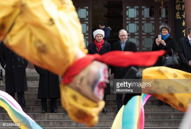 Theresa May UK prime minister center and her husband Philip May center right watch a performance of Chinese opera at the Yellow Crane Tower in Wuhan...