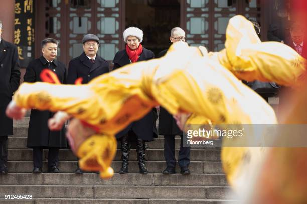 Theresa May UK prime minister center and her husband Philip May centre right watch a performance of Chinese opera at the Yellow Crane Tower in Wuhan...