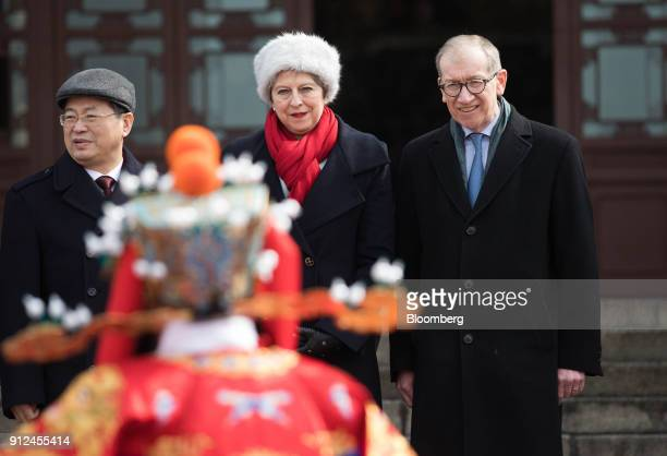 Theresa May UK prime minister center and her husband Philip May right watch a performance of Chinese opera at the Yellow Crane Tower in Wuhan China...