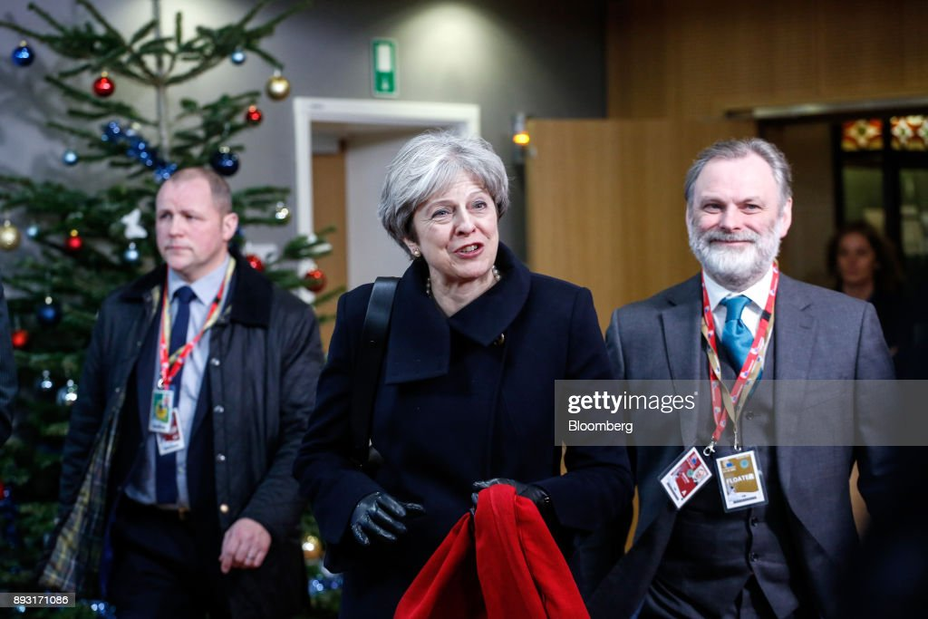 Theresa May, U.K. prime minister, center, and Tim Barrow, U.K. permanent representative to the European Union (EU), right, leave after attending a European Union (EU) leaders summit at the Europa Building in Brussels, Belgium, early on Friday, Dec. 15, 2017. May asked European leaders to be creative and to persevere to reach a deal when Brexit negotiations move on to trade. Photographer: Dario Pignatelli/Bloomberg via Getty Images