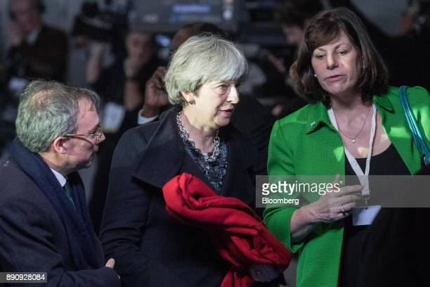 Theresa May UK prime minister center arrives at the One Planet Summit in Paris France on Tuesday Dec 12 2017 French President Emmanuel Macron hosts...