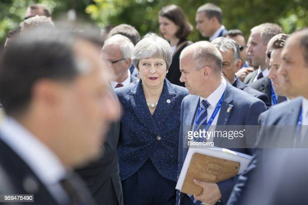 Theresa May UK prime minister center departs with other European Union and Balkan leaders following a family photo at a summit of EU leaders in Sofia...