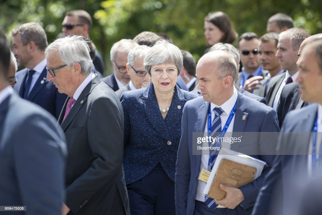 Theresa May, U.K. prime minister, center, departs with other European Union (EU) and Balkan leaders following a family photo at the summit of EU leaders in Sofia, Bulgaria, on Thursday, May 17, 2018. EU leaders presented a determined front to stand up to U.S. President Donald Trump's threats to penalize EU businesses and scupper the Iran nuclear deal. Photographer: Jasper Juinen/Bloomberg via Getty Images