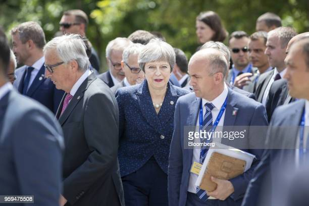 Theresa May UK prime minister center departs with other European Union and Balkan leaders following a family photo at the summit of EU leaders in...