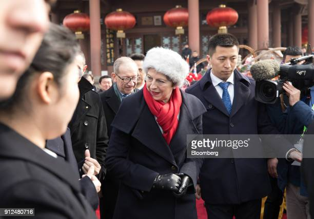 Theresa May UK prime minister center leaves after watching a performance of Chinese opera at the Yellow Crane Tower in Wuhan China on Wednesday Jan...
