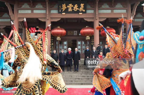Theresa May UK prime minister center left and her husband Philip May center right watch a performance of Chinese opera at the Yellow Crane Tower in...