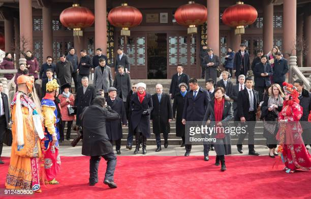 Theresa May UK prime minister center left and her husband Philip May center right leave after watching a performance of Chinese opera at the Yellow...