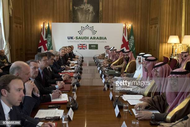 Theresa May UK prime minister center left and Mohammed bin Salman Saudi Arabia's crown prince center right listen during a meeting inside number 10...