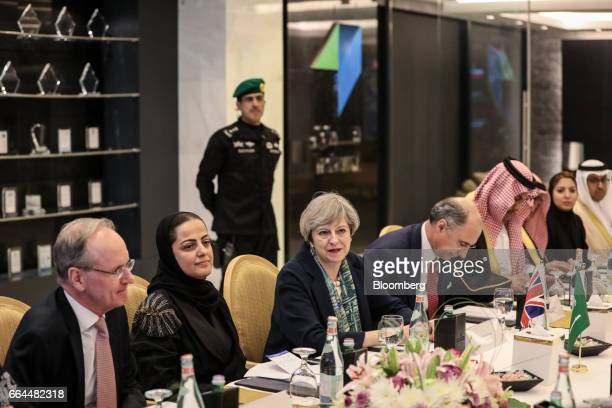Theresa May UK prime minister center looks on as she attends a meeting with Xavier Rolet chief executive officer of London Stock Exchange Group Plc...