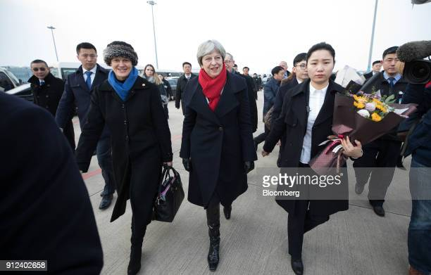 Theresa May UK prime minister center walks with Barbara Woodward third left UK ambassador to China after arriving in Wuhan China on Wednesday Jan 31...