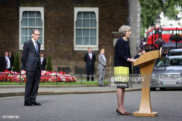 Theresa May UK prime minister delivers a speech as her husband Philip May looks on outside 10 Downing Street in London UK on Wednesday July 13 2016...