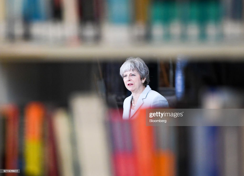 Theresa May, U.K. prime minister, delivers a speech on education at Derby College in Derby, U.K., on Monday, Feb. 19, 2018. May set out to repair her image with young voters with a warning over the cost and quality of university courses, and an acknowledgment that students were being failed by a funding system that leaves them with crippling debts. Photographer: Facundo Arrizabalaga/Pool via Bloomberg