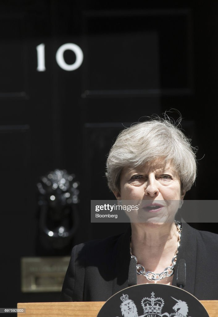 Theresa May, U.K. prime minister, delivers a statement outside number 10 Downing Street, in London, U.K., on Monday, June 19, 2017. U.K. police are treatingan incident in which a van plowed into a crowd outside a north London mosque as the third terrorist attackon the capital in as many months. Photographer: Simon Dawson/Bloomberg via Getty Images