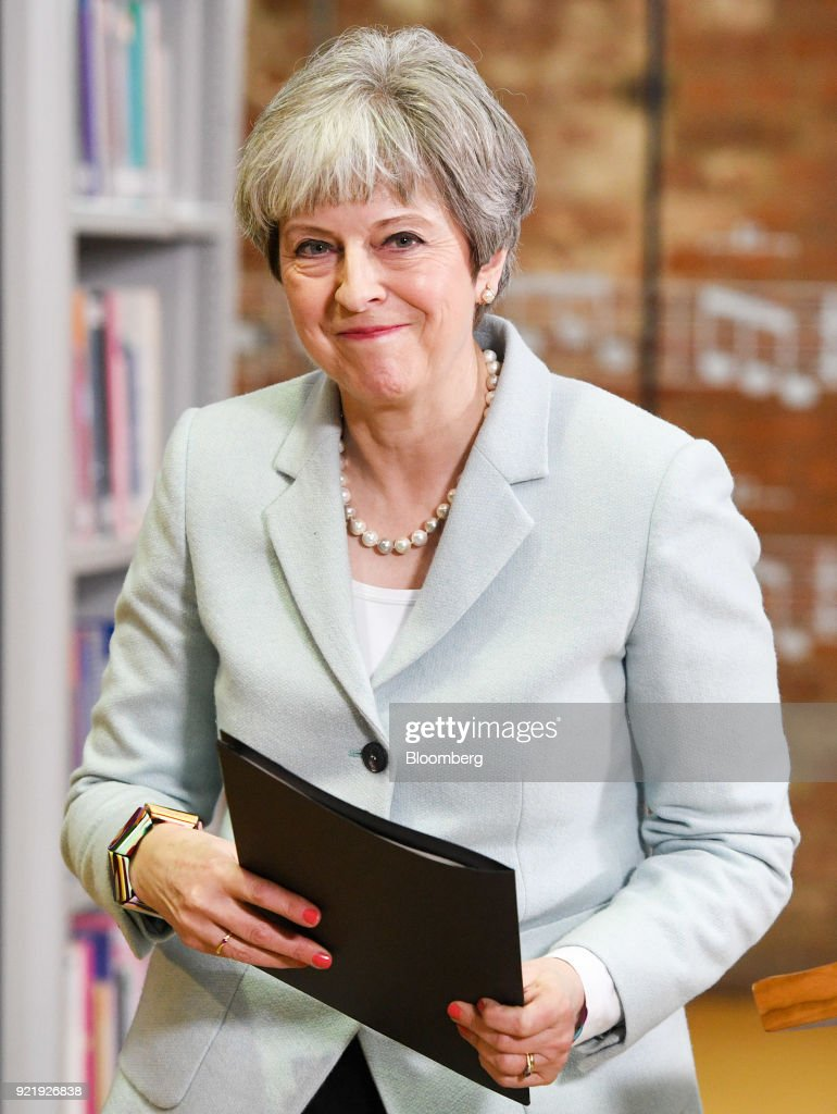 Theresa May, U.K. prime minister, departs after delivering a speech on education at Derby College in Derby, U.K., on Monday, Feb. 19, 2018. May set out to repair her image with young voters with a warning over the cost and quality of university courses, and an acknowledgment that students were being failed by a funding system that leaves them with crippling debts. Photographer: Facundo Arrizabalaga/Pool via Bloomberg