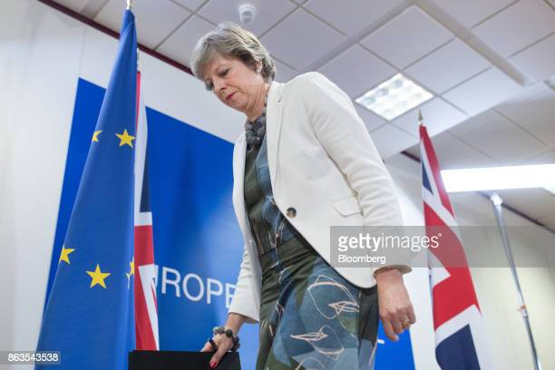 Theresa May UK prime minister departs following a news conference at a European Union leaders summit in Brussels Belgium on Friday Oct 20 2017 May...