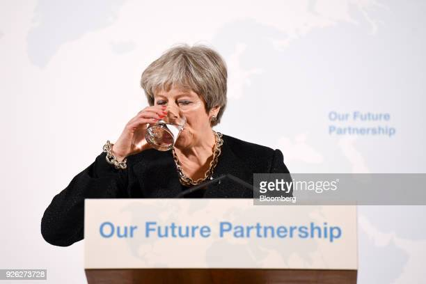 Theresa May UK prime minister drinks water while delivering a speech on Brexit at Mansion House in London UK on Friday March 2 2018 The UK prime...