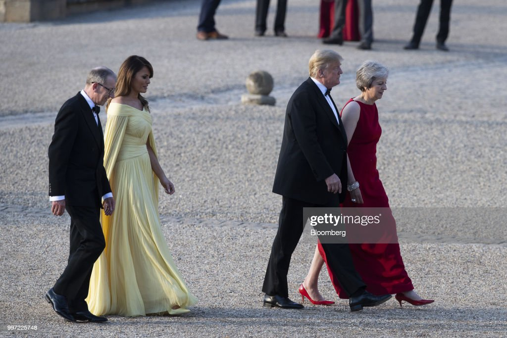 Theresa May, U.K. prime minister, from top left, and U.S. President Donald Trump, U.S. First Lady Melania Trump, and Philip May, husband of May, arrive at Blenheim Palace ahead of a dinner in Oxfordshire, U.K., on Thursday, July 12, 2018. Trump and the first lady will meet British business leaders at the black-tie dinner attended by more than 100 guests. Photographer: Will Oliver/Pool via Bloomberg