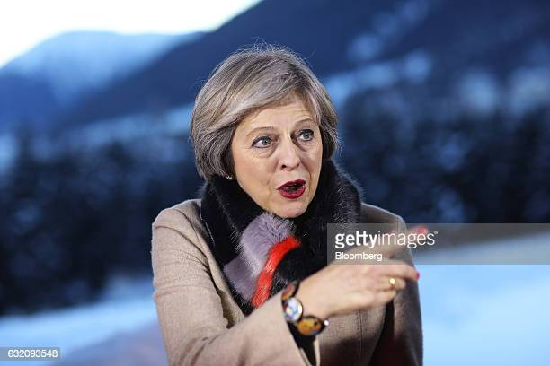 Theresa May UK prime minister gestures as she speaks following a Bloomberg Television interview during the World Economic Forum in Davos Switzerland...