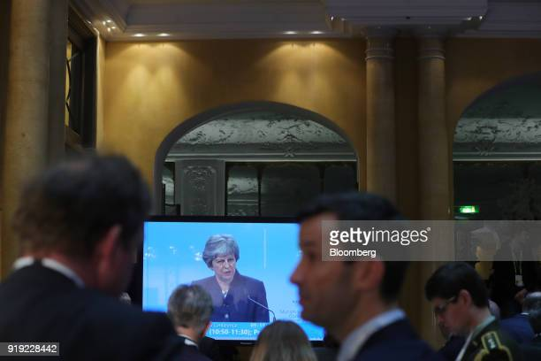 Theresa May UK prime minister is seen on a television screen at the Munich Security Conference in Munich Germany on Saturday Feb 17 2018 May will...