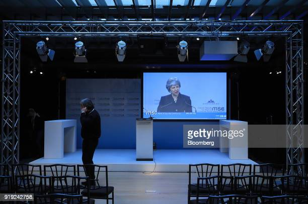 Theresa May UK prime minister is seen on a television screen at the Munich Security Conference in Munich Germany on Saturday Feb 17 2018 Mayproposed...