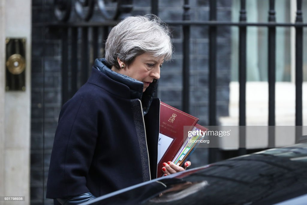 Theresa May, U.K. prime minister, leaves 10 Downing Street following a meeting in London, U.K., on Wednesday, March 14, 2018. May publicly blamed Russia for poisoning a former spy and his daughter on British soil, as escalating tension between the Kremlin and the West raised fears of a new Cold War. Photographer: Simon Dawson/Bloomberg via Getty Images