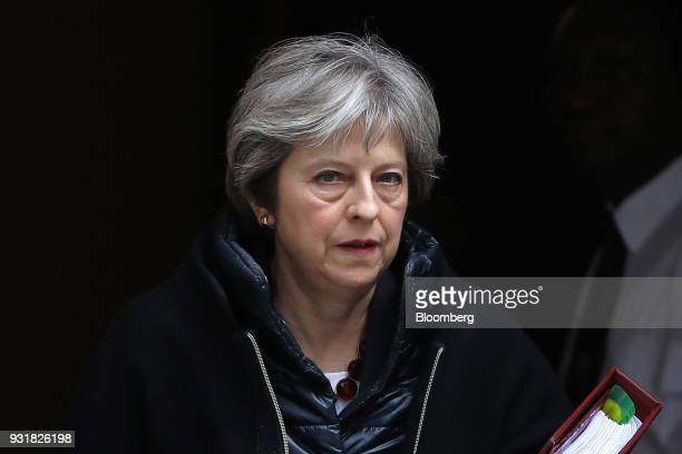 Theresa May UK prime minister leaves 10 Downing Street following a meeting in London UK on Wednesday March 14 2018 Maypublicly blamed Russia for...