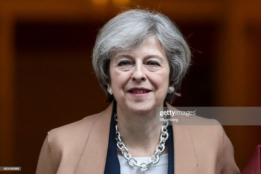 Theresa May, U.K. prime minister, leaves 10 Downing Street to attend the weekly question-and-answer session in the House of Commons, in London, U.K., on Wednesday, March 15, 2017. The European Union is considering forcing the U.K. to wait until June for formal negotiations to begin on the terms of Brexit, eroding the time May has to land a deal, according to EU officials. Photographer: Simon Dawson/Bloomberg via Getty Images