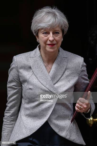 Theresa May UK prime minister leaves number 10 Downing Street in London UK on Tuesday June 13 2017 There has been criticism of May for seeking a deal...
